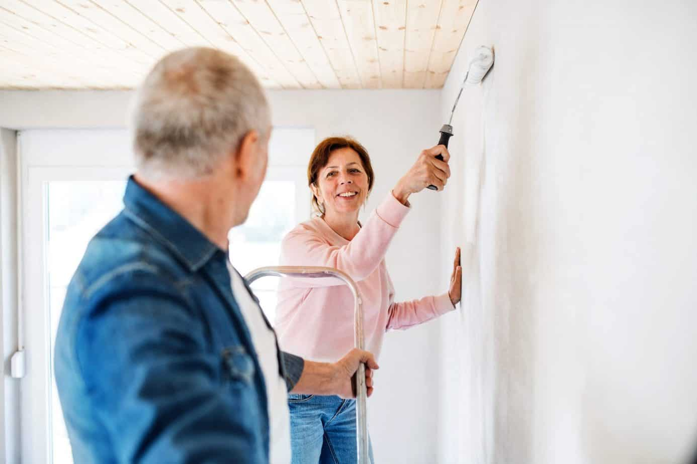 retirees painting home