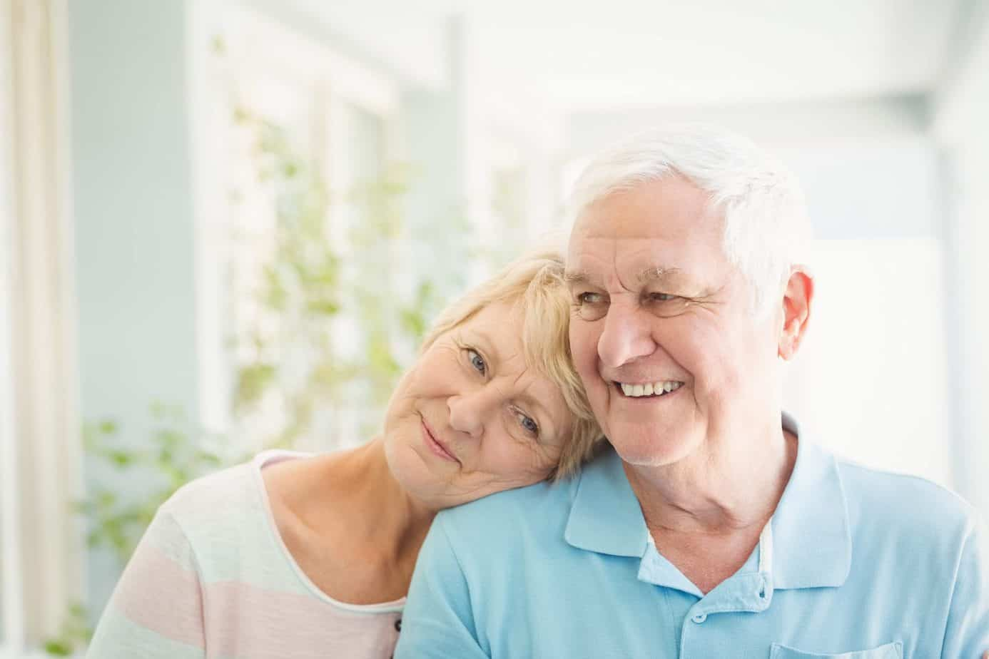 retirees smiling with peace of mind