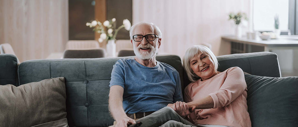 elder-couple-enjoying-time-together-at-home-1000x429