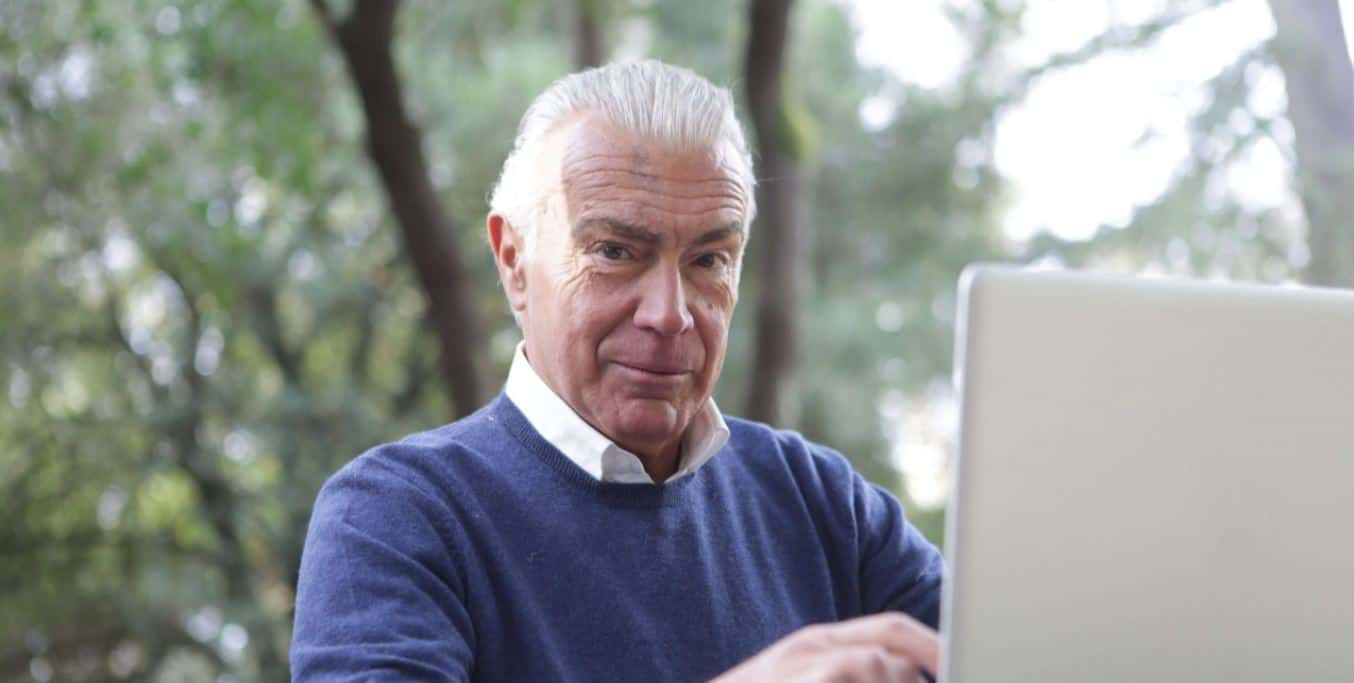 elderly man on laptop